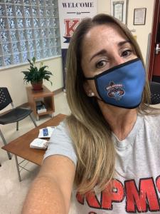Principal Coto-Gonzalez wearing a face mask